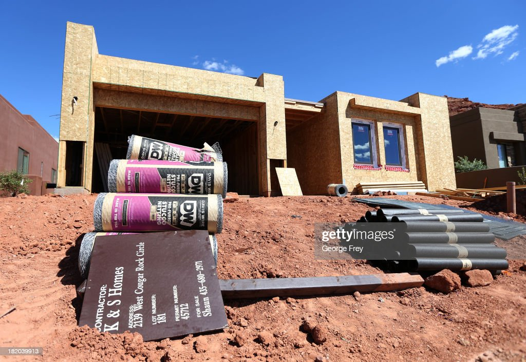 Materials are shown piled outside a single family home under construction September 27, 2013 in St. George, Utah. Housing starts on single-family rose at a faster pace in August, and building permits rose to a five-year high, according to published reports this week.