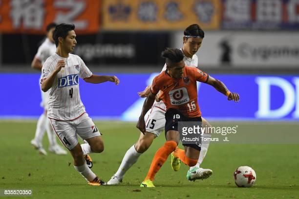 Mateus of Omiya Ardija controls the ball under pressure of Riki Harakawa and Jung Seung Hyun of Sagan Tosu during the JLeague J1 match between Sagan...
