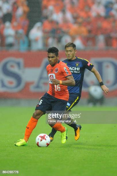 Mateus of Omiya Ardija controls the ball under pressure of Ryuta Koike of Kashiwa Reysol during the JLeague J1 match between Omiya Ardija and Kashiwa...