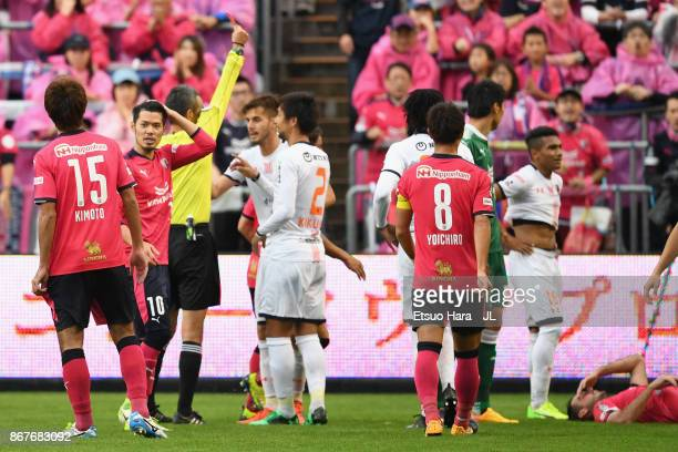 Mateus of Omiya Ardija is shown a red card by referee Itaru Hirose after fouling on Matej Jonjic of Cerezo Osaka during the JLeague J1 match between...