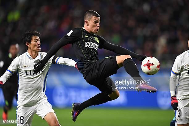 Mateus Uribe of Atletico Nacional kicks the ball during the FIFA Club World Cup Japan semifinal match between Atletico Nacional and Kashima Antlers...