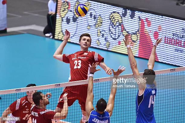 Mateusz Bieniek of Poland spikes in the match between Italy and Poland during the FIVB Men's Volleyball World Cup Japan 2015 at Yoyogi National...