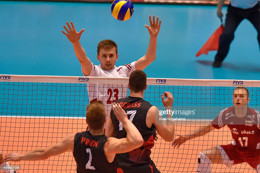 Mateusz Bieniek #23 of Polandblocks the ball during the Men's World Olympic Qualification game between Poland and Canada at Tokyo Metropolitan Gymnasium on May 28, 2016 in Tokyo, Japan.
