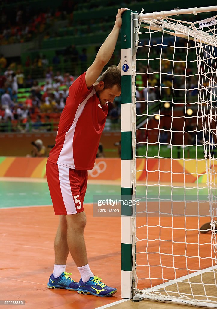 Mateusz Jachlewski of Poland looks dejected follwoing his team's defeat in the Men's Handball Semifinal match between Poland and Denmark on Day 14 of...