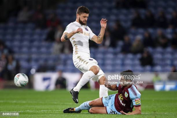 Mateusz Klich Fans of Leeds United and Ashley Westwood of Burnley during the Carabao Cup Third Round match between Burnley and Leeds United at Turf...