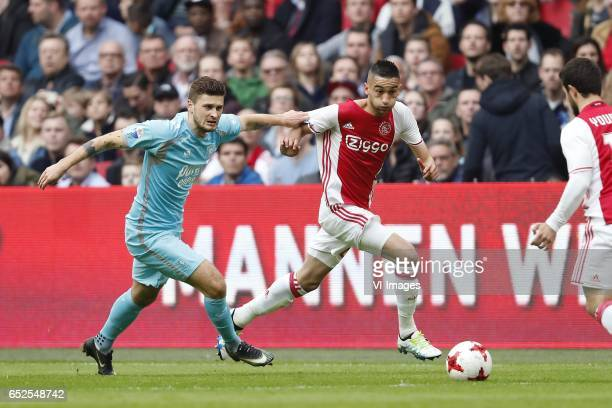 Mateusz Klich of FC Twente Hakim Ziyech of Ajax Amin Younes of Ajaxduring the Dutch Eredivisie match between Ajax Amsterdam and FC Twente Enschede at...