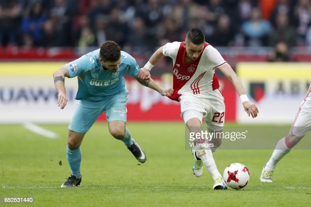 Mateusz Klich of FC Twente Hakim Ziyech of Ajaxduring the Dutch Eredivisie match between Ajax Amsterdam and FC Twente Enschede at the Amsterdam Arena...