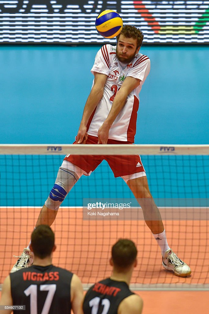 Mateusz Mika #20 of Poland spikes the ball during the Men's World Olympic Qualification game between Poland and Canada at Tokyo Metropolitan Gymnasium on May 28, 2016 in Tokyo, Japan.