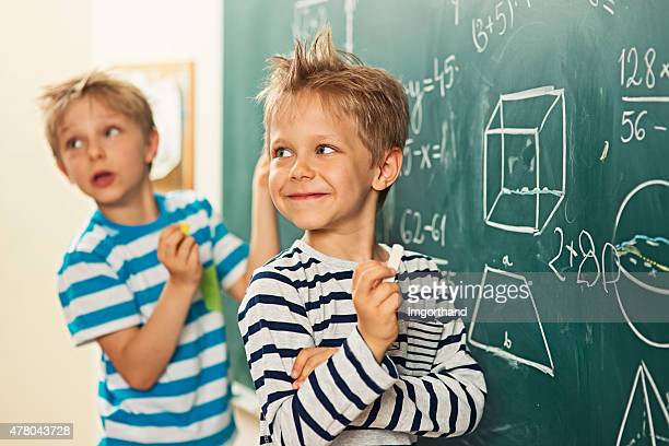Math is fun - boys standing at the blackboard
