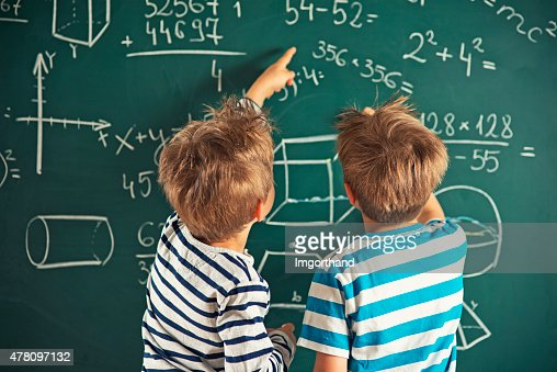 Math is fun - little boys solving mathematical problems