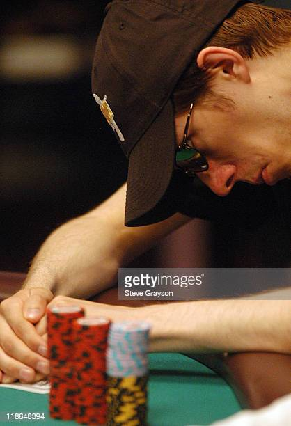 Mathais Anderson takes a peek at his hand during day six of the 2004 World Series of Poker at Binion's Horseshoe Club and Casino in Las Vegas Nevada...