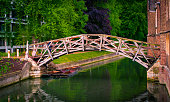 Mathematical bridge in spring over Cam river next to Presidents Lodge, Cambridge, England.