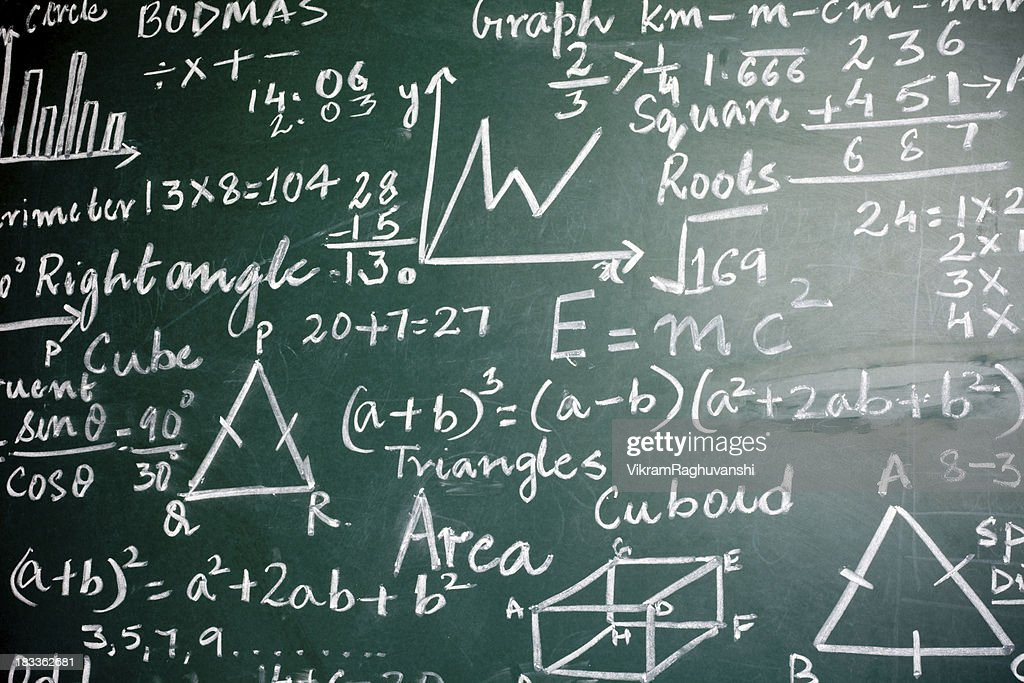 Mathematics Problems on a Greenboard : Stock Photo