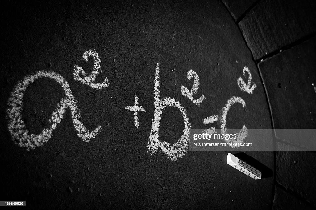 Mathematics sum on black board : Stock Photo