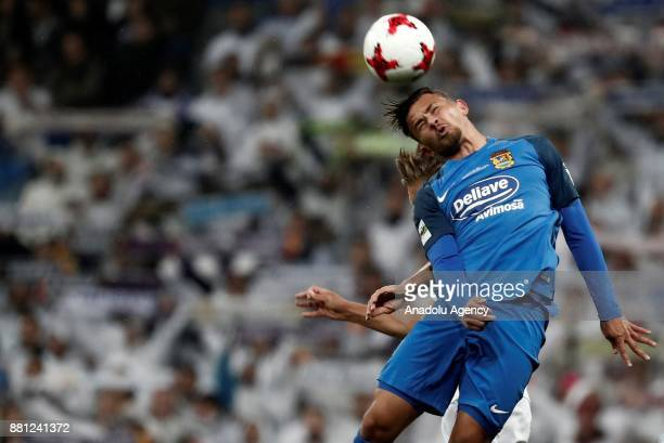 Matheus Barrozo of Fuenlabrada in action against Marcos Llorente of Real Madrid during King's Cup soccer match between Real Madrid and Fuenlabrada at...