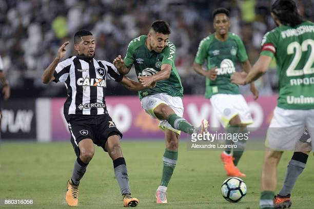 Matheus Fernandes of Botafogo battles for the ball with Alan Ruschel of Chapecoense during the match between Botafogo and Chapecoense as part of...