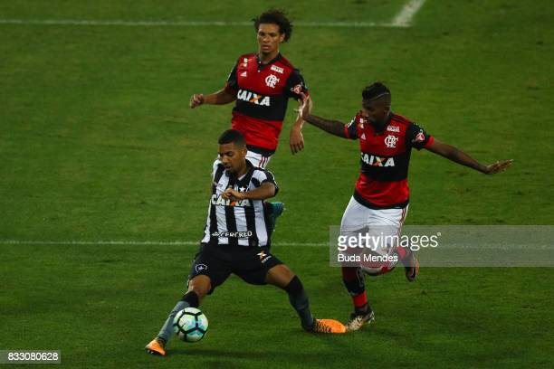 Matheus Fernandes of Botafogo struggles for the ball with Rodinei of Flamengo during a match between Botafogo and Flamengo as part of Copa do Brasil...