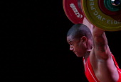 Matheus Machado of Brazil A competes in Men's 105kg during day seven of the 2013 Junior Weightlifting World Championship at Maria Angola Convention...