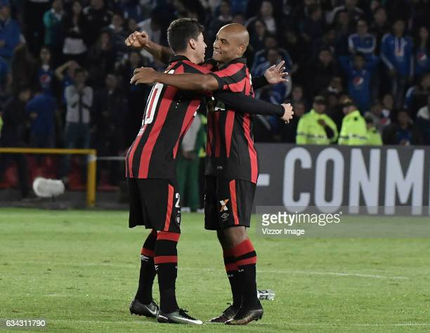 Matheus Rossetto and Wanderson of Atletico Paranaense celebrate after a match between Millonarios and Atletico Paranaense as part of Copa...