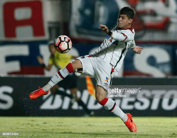 Matheus Rossetto of Atletico Paranaense kicks the ball during a group stage match between San Lorenzo and Atletico Paranaense as part of Copa...