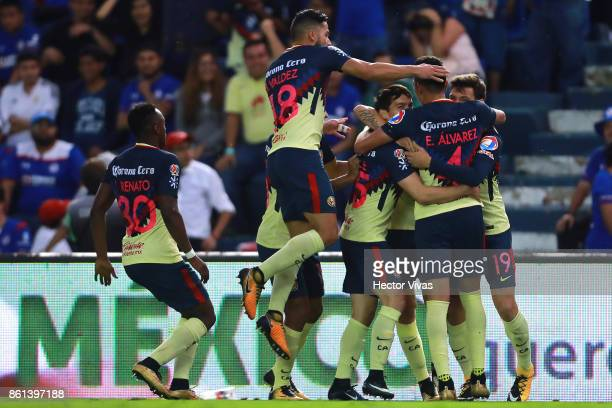 Mateus Uribe of America celebrates with teammates after scoring the third goal of his team during the 13th round match between Cruz Azul and America...