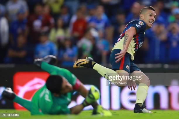 Mateus Uribe of America shoots on target and scores the third goal of his team during the 13th round match between Cruz Azul and America as part of...