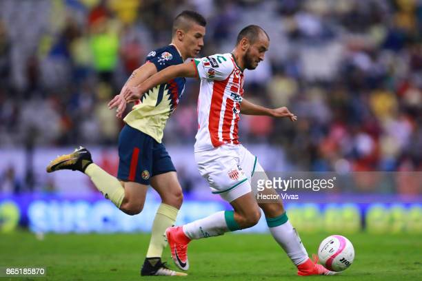 Mateus Uribe of America struggles for the ball with Carlos Gonzalez of Necaxa during the 14th round match between America and Necaxa as part of the...
