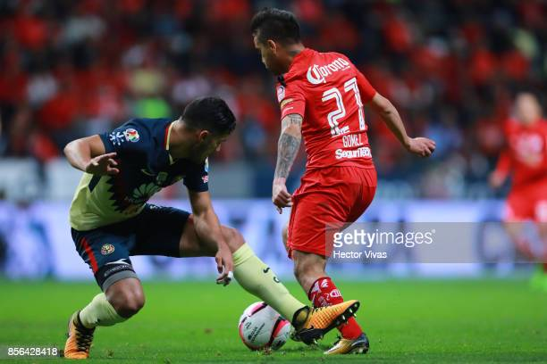 Mateus Uribe of America struggles for the ball with Rodrigo Gomez of Toluca during the 12th round match between Toluca and America as part of the...