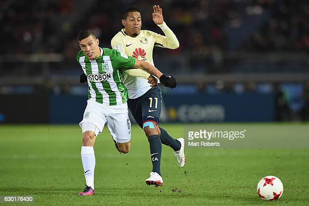 Mateus Uribe of Atletico Nacional competes for the ball against Michael Arroyo of Club America during the FIFA Club World Cup 3rd place match between...