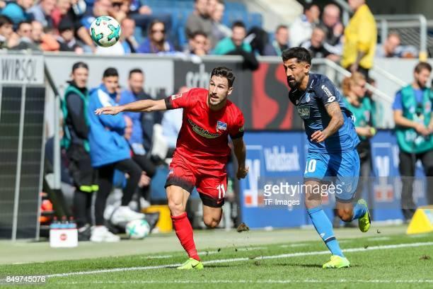 Mathew Allan Leckie of Berlin and Kerem Demirbay of Hoffenheim battle for the ball during the Bundesliga match between TSG 1899 Hoffenheim and Hertha...