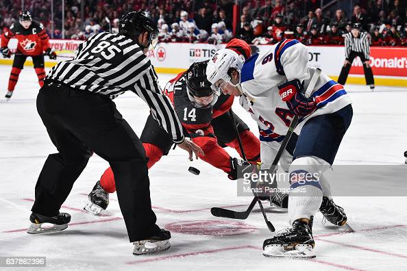 Mathew Barzal of Team Canada and Luke Kunin of Team United States faceoff during the 2017 IIHF World Junior Championship gold medal game at the Bell...
