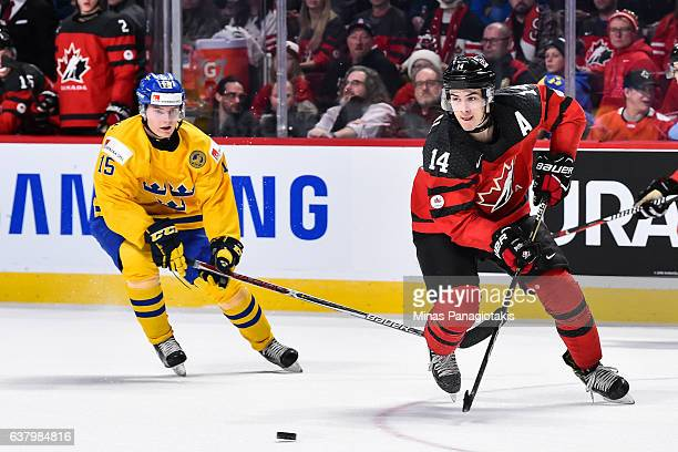 Mathew Barzal of Team Canada plays the puck past Lias Andersson of Team Sweden during the 2017 IIHF World Junior Championship semifinal game at the...