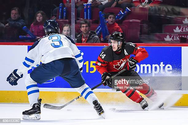 Mathew Barzal of Team Canada skates the puck against Urho Vaakanainen of Team Finland during the IIHF exhibition game at the Bell Centre on December...