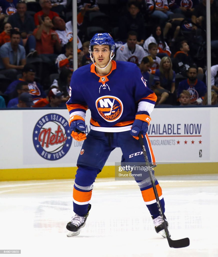 Mathew Barzal #13 of the New York Islanders skates against the Philadelphia Flyers during a preseason game at the Nassau Veterans Memorial Coliseum on September 17, 2017 in Uniondale, New York. The Islanders defeated the Flyers 3-2 in overtime.