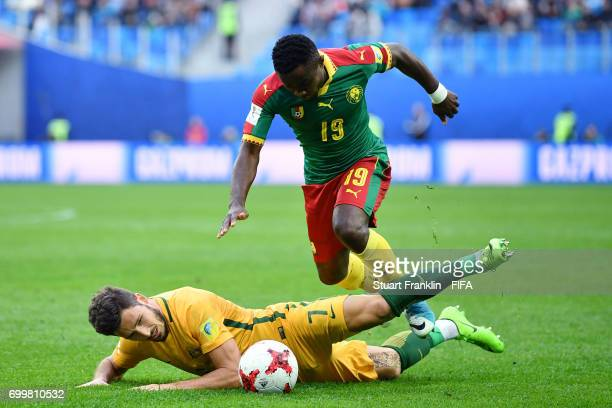 Mathew Leckie of Australia and Collins Fai of Cameroon battle for possession during the FIFA Confederations Cup Russia 2017 Group B match between...