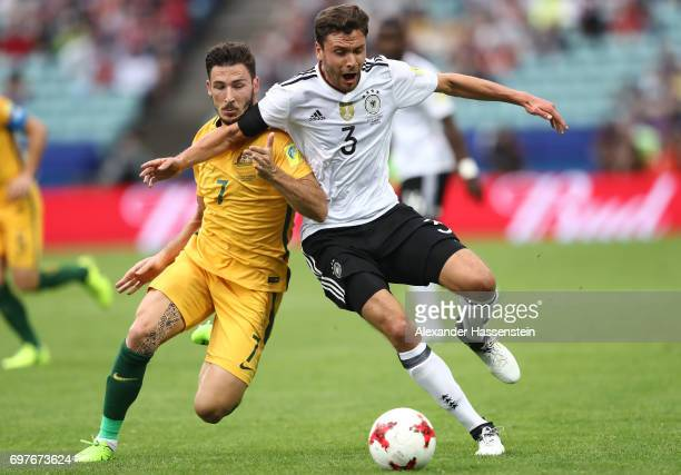 Mathew Leckie of Australia and Jonas Hector of Germany battle for possession during the FIFA Confederations Cup Russia 2017 Group B match between...