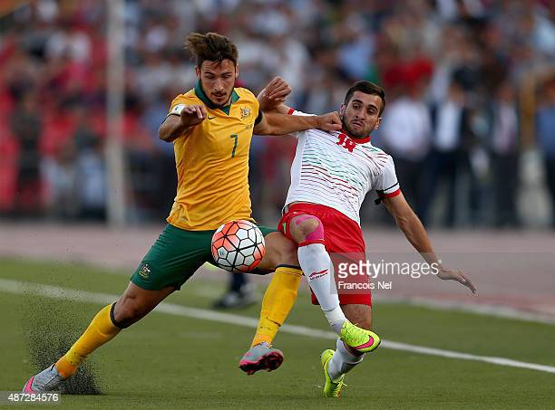 Mathew Leckie of Australia battles for the ball with Fathullo Fathuloev of Tajikistan during the 2018 FIFA World Cup Qualifier match between the...