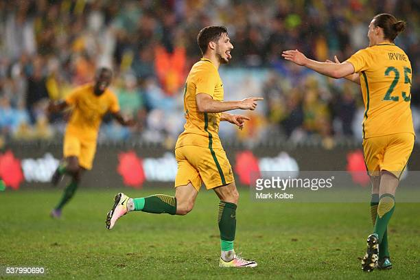 Mathew Leckie of Australia celebrates with Jackson Irvine of Australia after scoring a goal during the international friendly match between the...