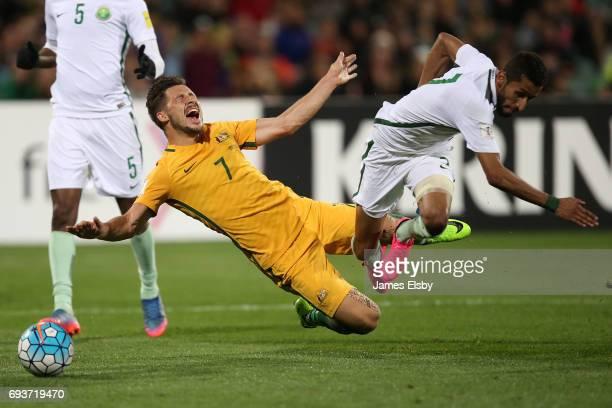 Mathew Leckie of Australia clashes with Salman Alfaraj of Saudi Arabia during the 2018 FIFA World Cup Qualifier match between the Australian...