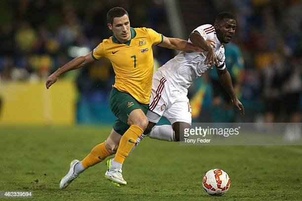 Mathew Leckie of Australia contests the ball with Ismail Al Hammadi of the United Arab Emirates during the Asian Cup Semi Final match between the...