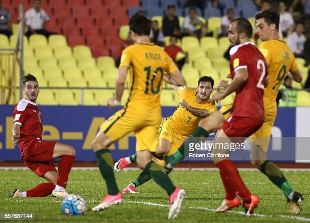 Mathew Leckie of Australia crosses the ball to Robbie Kruse of Australia during the 2018 FIFA World Cup Asian Playoff match between Syria and the...