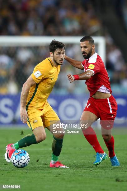 Mathew Leckie of Australia dribbles the ball during the 2018 FIFA World Cup Asian Playoff match between the Australian Socceroos and Syria at ANZ...