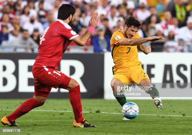 Mathew Leckie of Australia has his shot blocked by Tamer Hag Mohamad of Syria during their 2018 World Cup football qualifying match against Syria...