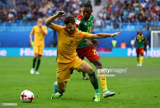 Mathew Leckie of Australia is tackled by Karl Toko Ekambi of Cameroon during the FIFA Confederations Cup Russia 2017 Group B match between Cameroon...
