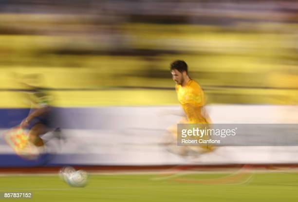 Mathew Leckie of Australia runs with the ball during the 2018 FIFA World Cup Asian Playoff match between Syria and the Australia Socceroos at Hang...