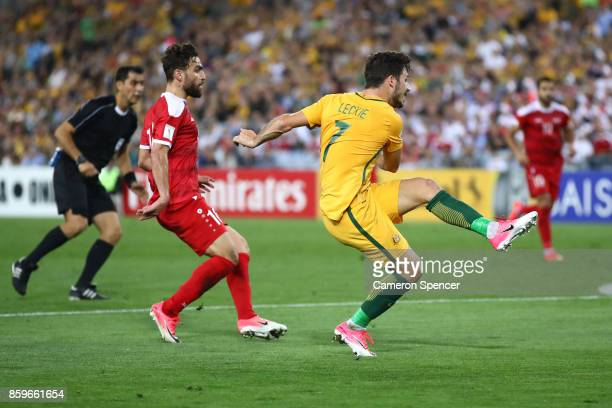 Mathew Leckie of Australia strikes the ball during the 2018 FIFA World Cup Asian Playoff match between the Australian Socceroos and Syria at ANZ...