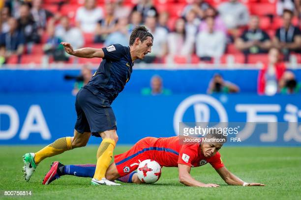 Mathew Leckie of Australia tackles Alexis Sanchez of Chile during the FIFA Confederations Cup Russia 2017 group B football match between Chile and...
