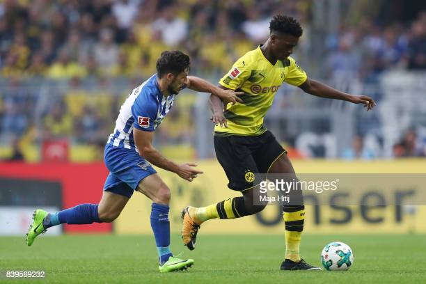 Mathew Leckie of Berlin and DanAxel Zagadou of Dortmund during the Bundesliga match between Borussia Dortmund and Hertha BSC at Signal Iduna Park on...