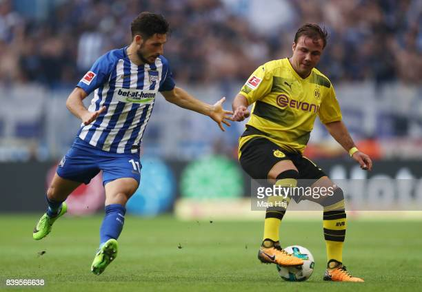 Mathew Leckie of Berlin and Mario Goetze of Dortmund during the Bundesliga match between Borussia Dortmund and Hertha BSC at Signal Iduna Park on...