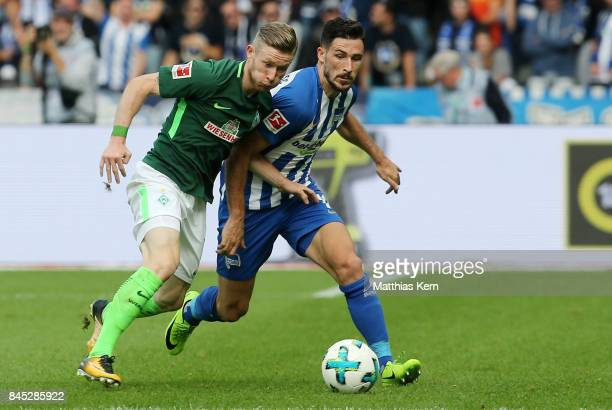 Mathew Leckie of Berlin battles for the ball with Florian Kainz of Bremen during the Bundesliga match between Hertha BSC and SV Werder Bremen at...